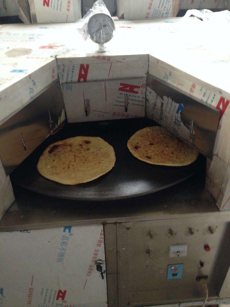内蒙古呼和浩特土默特左旗人工手动转炉烧饼压饼机